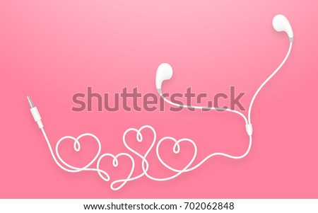 Earphones, Earbud type white color and heart symbol made from cable isolated on pink gradient background, with copy space