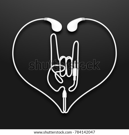 Earphones, Earbud type white color and Rock hand sign language with heart shape frame made from cable isolated on black gradient background, with copy space