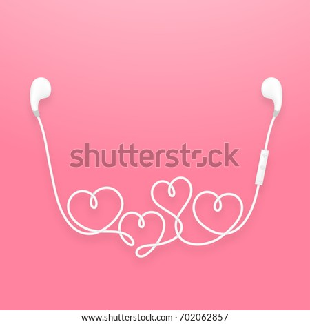 Earphones wireless and remote, earbud type white color and heart symbol made from cable isolated on pink gradient background, with copy space