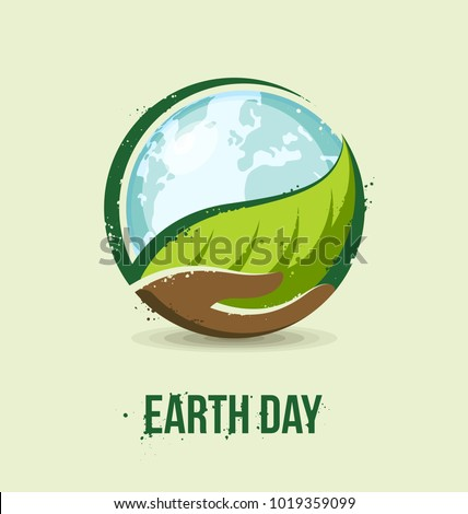 Earth Day concept. Hand holding a leaf and earth