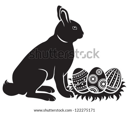 Easter bunny hatches decorated eggs