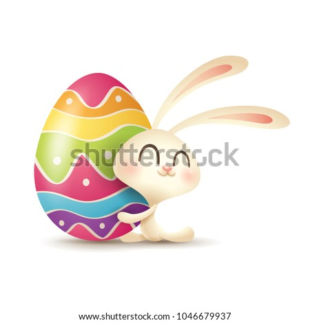 Easter bunny hugs a painted egg.