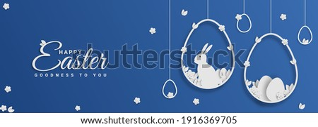 Easter card with hanging egg shaped paper frame with spring flowers on blue background.Easter bunny vector illustration.