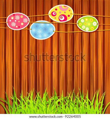 Easter eggs on a wooden wall background