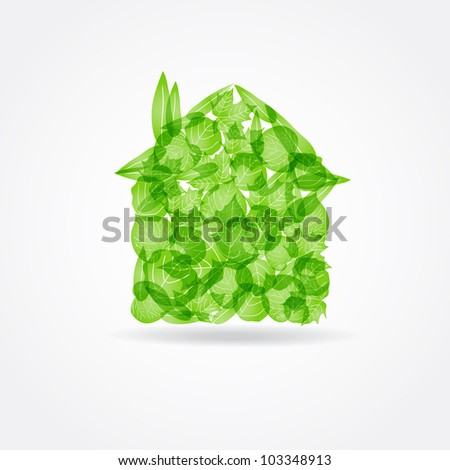 Ecological concept. Small green house from fresh leaves