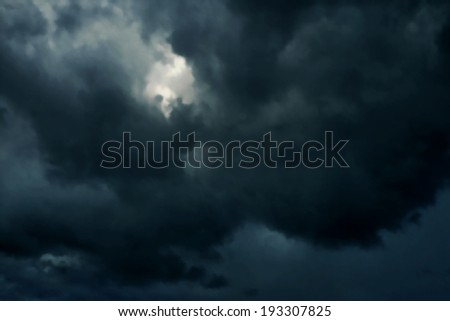 Editable vector illustration of dark heavy rainclouds made with a gradient mesh