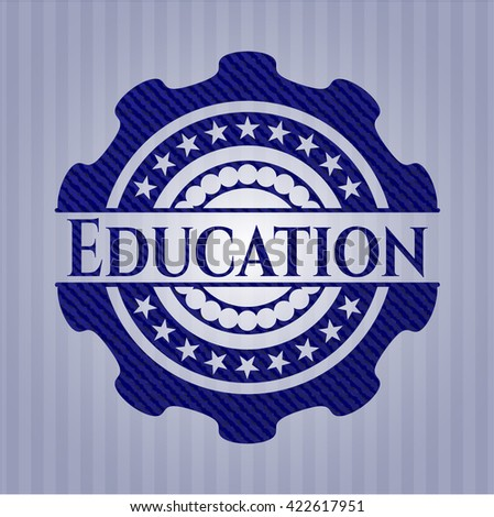 Education emblem with jean background