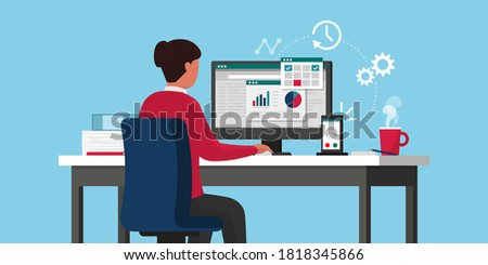 Efficient businesswoman working online, she is sitting at desk and checking business charts on the computer, remote work concept Photo stock ©