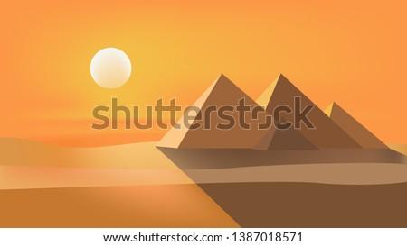 egyptian pyramids and beautiful orange sunset. vector desert illustration