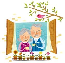 Elderly couple drinking cup of tea beside window