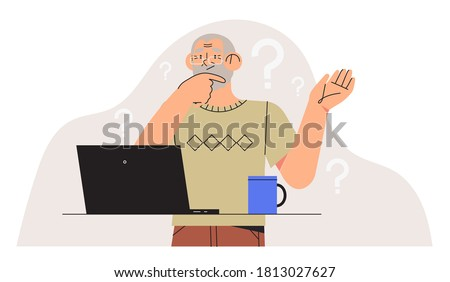 Elderly person study to work on notebook or computer and having difficulties. Older generation problems using technology. Confused Senior man with computer trying to figure out with new technologies. Foto stock ©