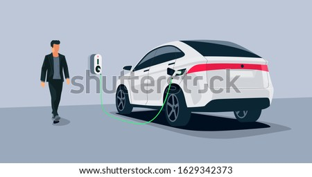 Electric car charging in underground garage home plugged charger station. Vector illustration battery EV vehicle standing parking connected to wallbox. Vehicle being charged with power supply socket.  Stockfoto ©