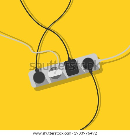 Electric extension cord. A mess of cables from extension cord, electrical wires, cords and chargers on a yellow background. Power strip. Cable management. Electric overload. Photo stock ©