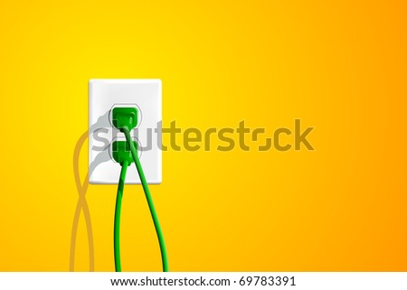 Electrical outlet with two green plugs and lots of copy space on the right.