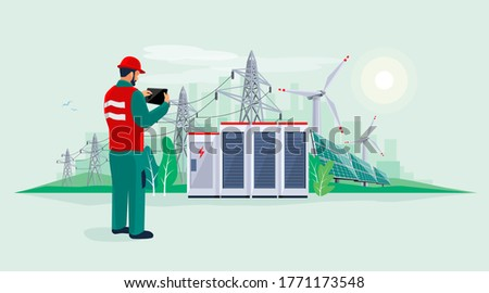 Electrician technician engineer man diagnostics electricity power supply grid transmission. Person inspection production facility. Renewable solar panel wind energy plant with battery storage.  stock photo