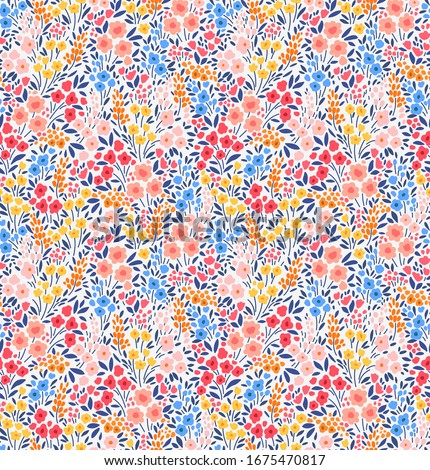 Elegant floral pattern in small multi colored flowers. Liberty style. Floral seamless background for fashion prints. Vintage print. Seamless vector texture. Spring bouquet.