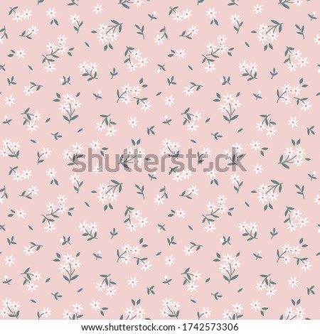 Elegant floral pattern in small white flowers. Liberty style. Floral seamless background for fashion prints. Vintage print. Seamless vector texture.