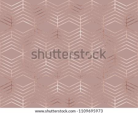 Elegant geometric seamless pattern with rose gold rhombuses.