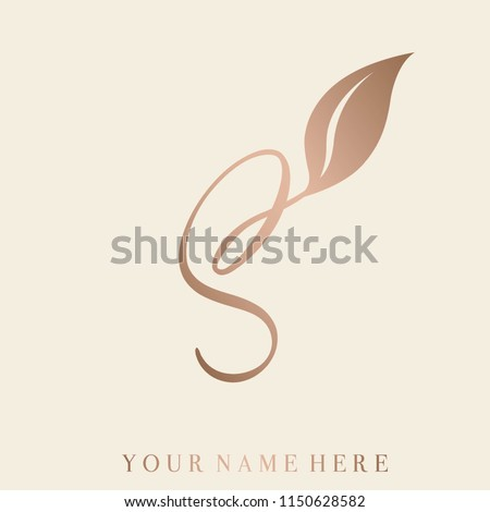 Elegant hand drawn letter S with leaf.Rose gold color calligraphic lettering.Lettering logo.Initial s icon isolated on light background.