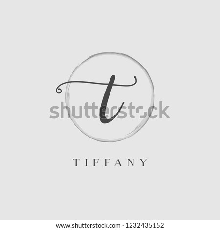 Elegant Initial Letter Type T Logo With Brushed Circle