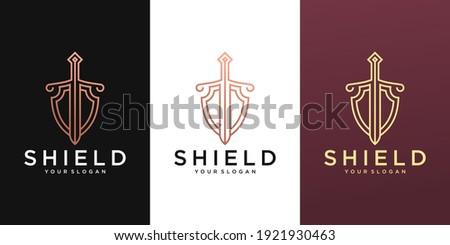 Elegant Shield logo designs concept vector, Guardian symbol, Shield and Sword logo template  Photo stock ©