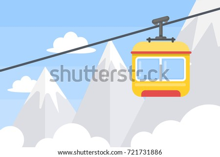 Elevator in mountains. Blue sky with white snowy peaks.