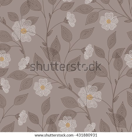 Embroidered flowers and leaves on brown background. Seamless pattern for your design