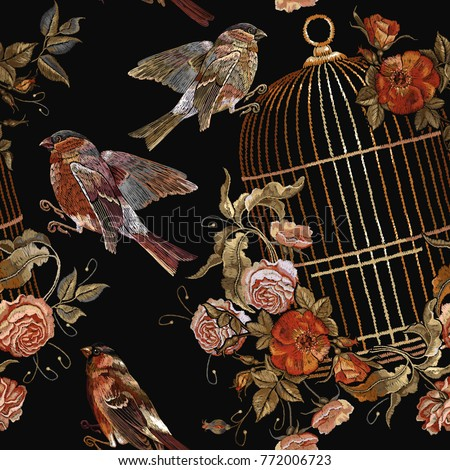Embroidery birds and birds cage and flowers vintage seamless pattern. Template for design of clothes, t-shirt. Classical embroidery bullfinch and titmouse, golden cage, vintage buds of wild roses