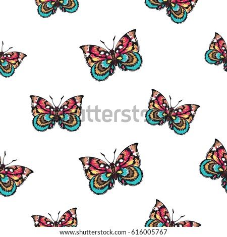 Embroidery colorful butterfly. Fashion patch with insects illustration. Seamless pattern backdrop. Trendy traditional art on white background.