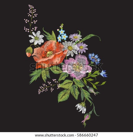 Embroidery colorful floral pattern with dog rose, chamomiles and cornflowers. Vector traditional folk fashion ornament on black background for design.