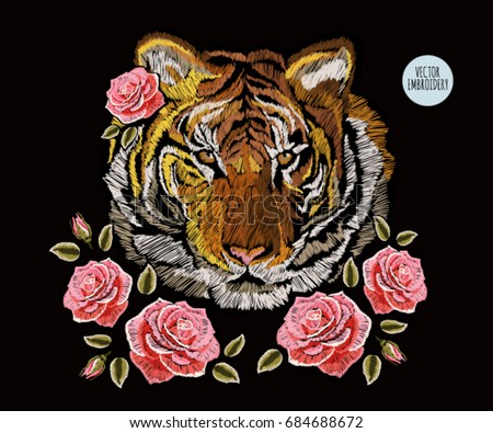 Shutterstock Embroidery colorful floral pattern with roses, japanese tiger. Vector traditional folk fashion ornament on black background.