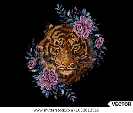 Embroidery colorful floral pattern with tiger head, ethnic flowers vector illustration. Traditional folk fashion ornament on black background.