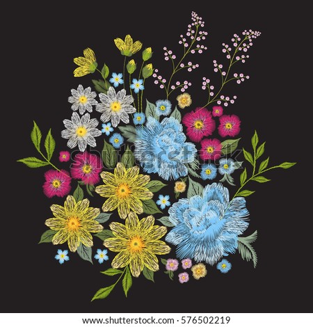 Embroidery colorful trend floral pattern. Vector traditional folk blue roses, chamomile, forget me not flowers bouquet on black background for clothing design
