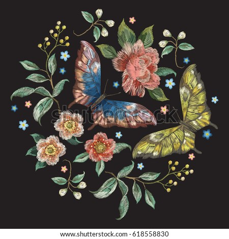 Embroidery colorful trend floral pattern with flowers and butterflies . Vector traditional folk roses and forget me not flowers bouquet on black background for design.