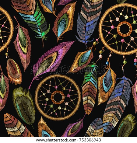 Embroidery dream catcher boho seamless pattern. Native american indian talisman dream catcher. Fashionable template design clothes. Magic tribal feathers pattern, t-shirt design. Clothes ethnic style