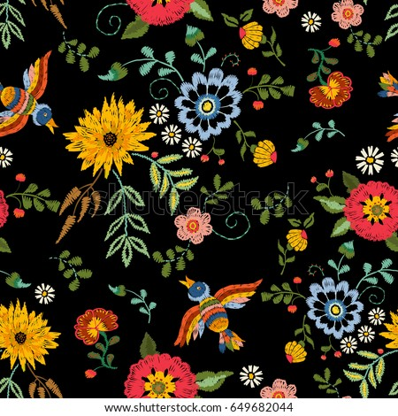 Embroidery ethnic seamless pattern with birds and fantasy flowers. Vector embroidered traditional floral design for fashion fabric.