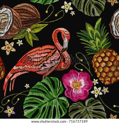 Embroidery flamingo, palm tree leaves, pineapple, coconut tropical seamless pattern. Fashionable template for design of clothes. Tropical embroidery pink flamingos, summer background