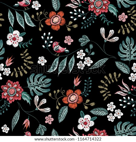 Embroidery floral neckline pattern with flowers and birds. Vector embroidered bouquet with flowers for wearing design.
