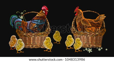 Embroidery hen, rooster and chickens in a basket. Template for clothes, textiles, t-shirt design. Classical embroidery beautiful yellow chickens and rooster