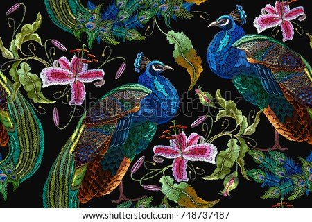 Embroidery peacocks and orchid exotic tropical flowers. seamless pattern. Classical fashionable embroidery beautiful peacocks. Fashionable template for design of clothes. Tails of peacocks and orchid
