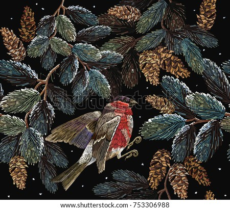 Embroidery red bullfinch and fir-tree branch with cones. Merry Christmas classical embroidery snow-covered branch of a fir-tree. Bullfinch on winter background Christmas art pattern