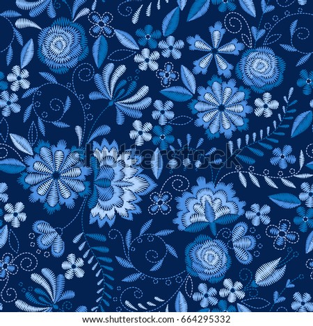 Embroidery seamless pattern with beautiful flowers. Vector floral ornament on dark blue background. Embroidery for fashion textile and fabric.