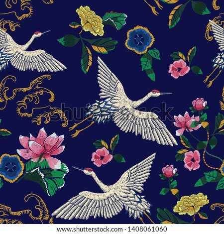 Embroidery seamless pattern with oriental cranes, waves and flowers. Vector embroidered floral patch.