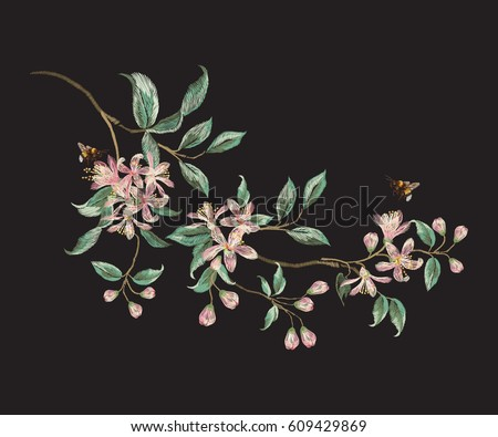 Embroidery trend floral pattern with branch of tropical japanese flowers. Vector traditional folk orange blossom and bees on black background for design