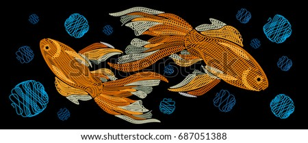 embroidery with golden fish on