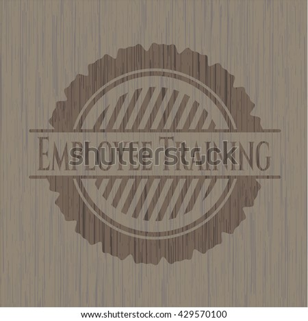 Employee Training badge with wooden background
