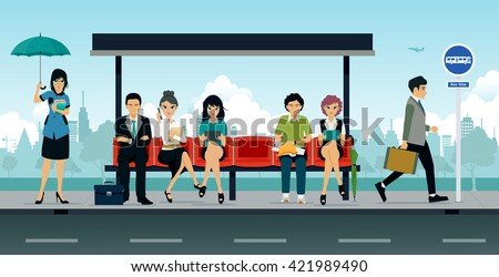 Employees and people were sitting at the bus stop.