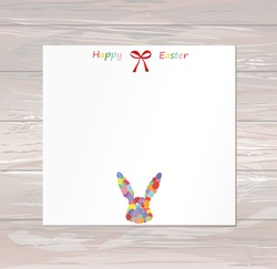 Empty blank for messages or greetings for Easter. Eggs with a pattern in the form of a bunny. Card for the holiday with a rabbit. Vector on wooden background.