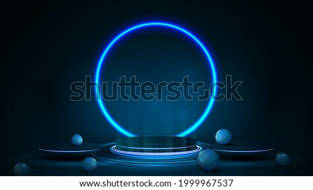 Empty blue podium for product presentation in form of winner pedestal with blue neon ring
