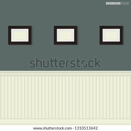 Empty brown wooden picture frames hanging on the wall decorating with wainscoting